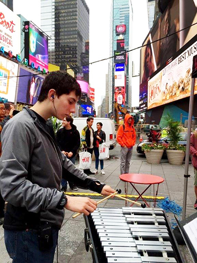 Devon playing marimbas with Mantra in Times Square.